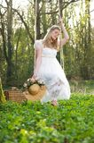 Young woman in white dress sitting on a swing outdoors Royalty Free Stock Photo