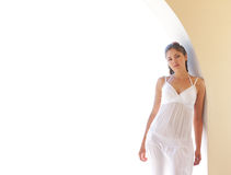 A young woman in a white dress on a vacation Royalty Free Stock Image