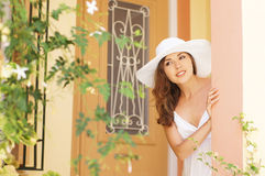 A young woman in a white dress on a vacation Stock Photography