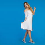 Young Woman In White Dress Is Walking And Smiling Stock Photography
