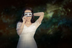 Young Woman in White Dress Wearing Mask Royalty Free Stock Image