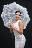 Young woman in white dress with white umbrella Royalty Free Stock Images