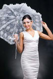 Young woman in white dress with white umbrella Stock Photo