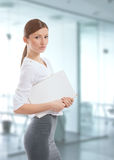 Young woman with the white folder at work Stock Photo