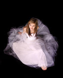 Young Woman in a White Gown. Beautiful young woman in a white gown, looking up Stock Photo