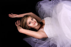 Young Woman in a White Gown Stock Images