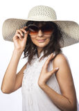 Young woman in white hat. Romantic portrait of young woman in white hat and big sunglasses Stock Photography