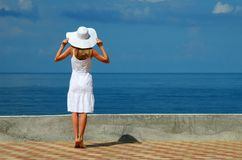 Young woman in a white hat Stock Photography