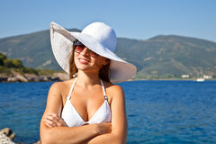 Young woman in white hat. Outdoor portrait of young woman in white hat Stock Photography