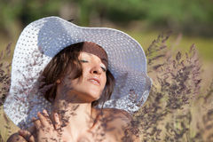 Young woman in white hat Royalty Free Stock Photos