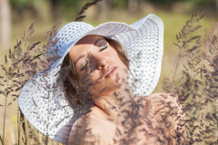 Young woman in white hat Royalty Free Stock Photo