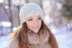 Young woman in white hat in park. Winter Royalty Free Stock Photo