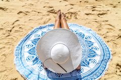 Young Woman With White Hat Relaxing On Beach royalty free stock images