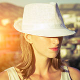 Young woman with white hat Royalty Free Stock Images