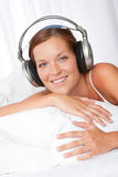 Young woman in white with headphones Royalty Free Stock Photography