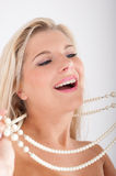 Young woman with white healthy teeth and pearls Stock Image