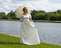 Young woman in white Stock Image