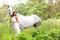 Young Woman with White Horse Royalty Free Stock Photos
