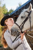 Young woman with a white horse Royalty Free Stock Photo