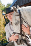 Young woman with a white horse Royalty Free Stock Images