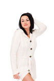 Young woman in white knitted dressing gown Royalty Free Stock Images