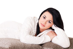 Young woman in white knitted dressing gown Royalty Free Stock Photo