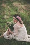 Young   woman in white lacy dress on meadow Royalty Free Stock Photos