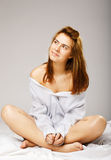 Young woman in a white men's shirt Stock Image