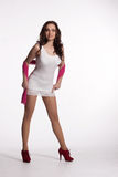 Young woman in a white mini dress, red heels with pink scarf Royalty Free Stock Photography