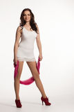 Young woman in a white mini dress, red heels with pink scarf Stock Photo