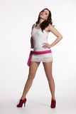 Young woman in a white mini dress, red heels with pink scarf Stock Photography