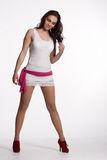 Young woman in a white mini dress, red heels with pink scarf Royalty Free Stock Photo