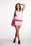 Young woman in a white mini dress, red heels with pink scarf Royalty Free Stock Photos