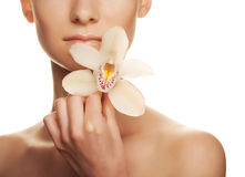 Young woman with white  orchid Royalty Free Stock Photos