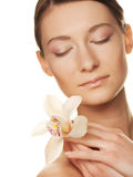 Young woman with white  orchid Stock Photo