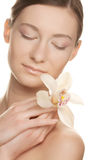 Young woman with white  orchid Stock Image