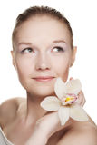 Young woman with white  orchid Royalty Free Stock Photo