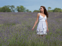 Young woman in white outdoors Royalty Free Stock Photography