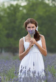 Young woman in white outdoors Royalty Free Stock Images