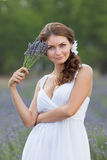 Young woman in white outdoors Stock Images