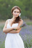 Young woman in white outdoors Stock Photos