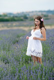 Young woman in white outdoors Stock Photography