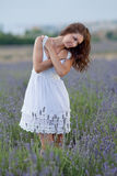 Young woman in white outdoors Stock Image