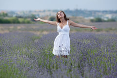 Young woman in white outdoors Royalty Free Stock Photos