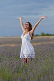 Young woman in white outdoors Royalty Free Stock Image