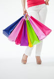 Young woman in white pants with shopping bags Royalty Free Stock Photo