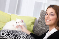 Young woman and a white Persian cat in the house Stock Photos