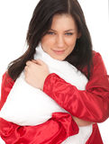 Young woman with white pillow Stock Photos