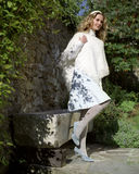 Young woman in a white poncho in the countryside Royalty Free Stock Image