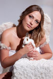 Young Woman With White Rabbit Stock Image